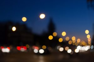 abstract bokeh defocused with car light on street